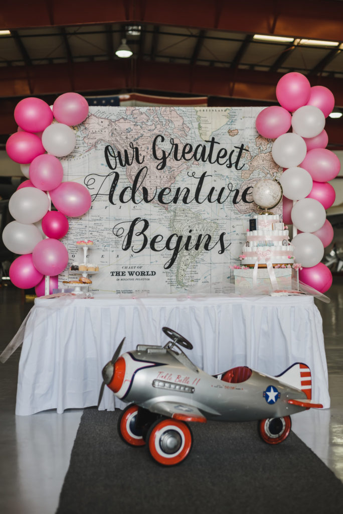 our greatest adventure begins dessert table at baby shower with mini airplane