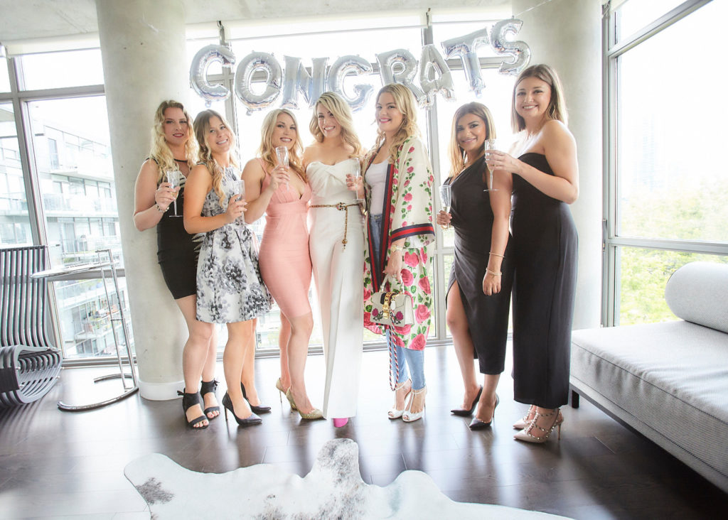 bridal party at engagement shower with champagne