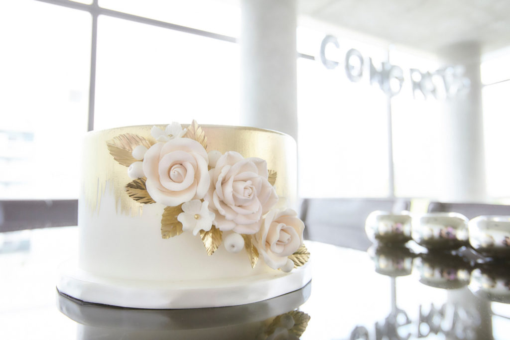 gold floral engagement shower cake