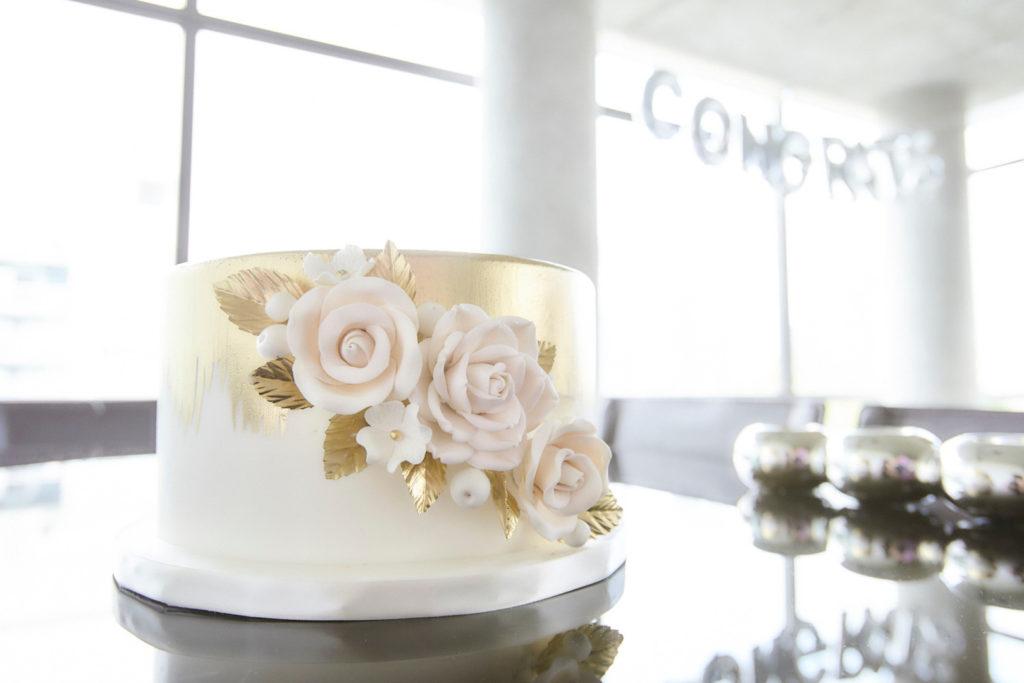 gold floral engagement shower cake