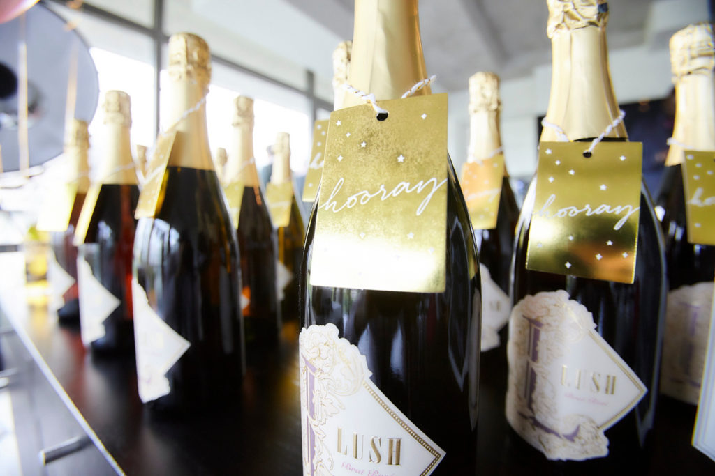 engagement party bottles of champagne with gold hooray favor tags