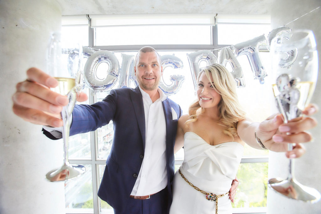 engaged couple with champagne at engagement party