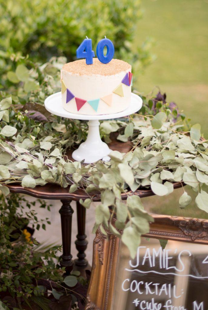 40th birthday cake on white pedestal