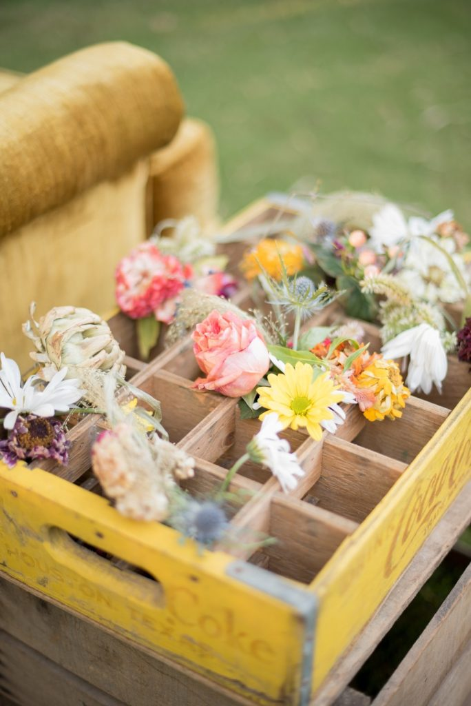 wild flowers in a wooden crate