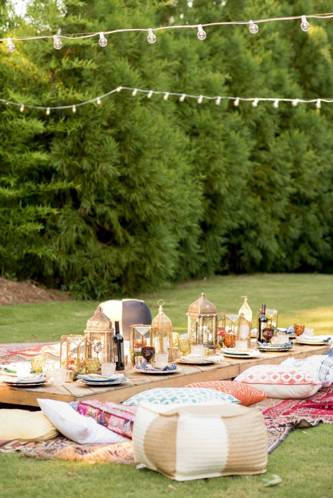 Moroccan birthday party with low outdoor seating