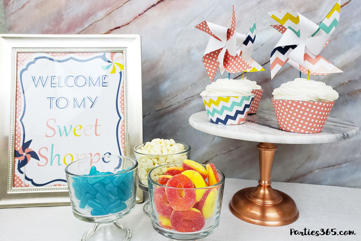 This pinwheel theme for a Sweet Shoppe is full of printable designs to make your birthday party pop! With ideas for decorations, favors, cupcake toppers, signs and more, you'll definitely want to download this free printable party set! #pinwheel #sweetshoppe #printables #partyideas