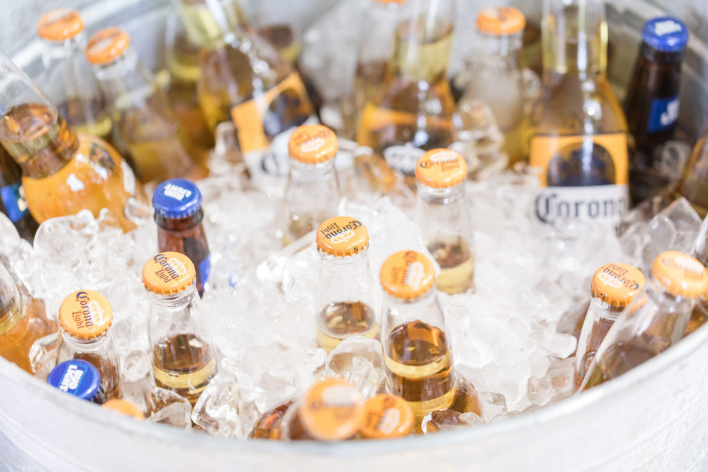ice filled bucket of beer at pool party