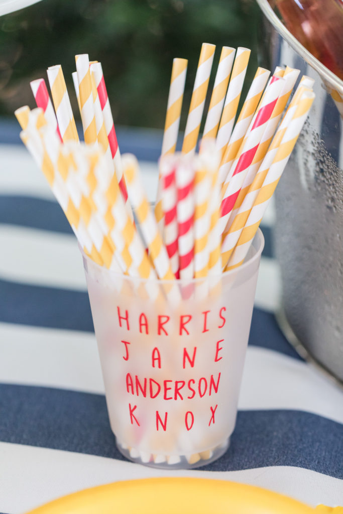 custom party cups for 2nd birthday party with red and yellow striped paper straws