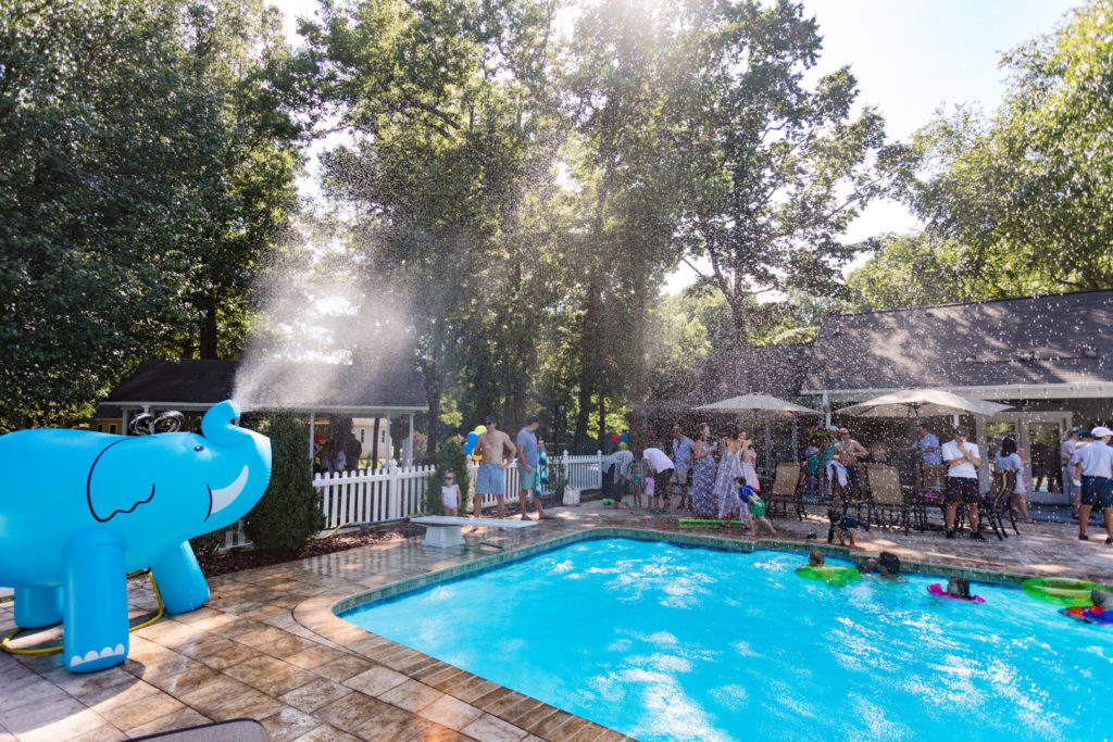 giant elephant sprinkler at pool party