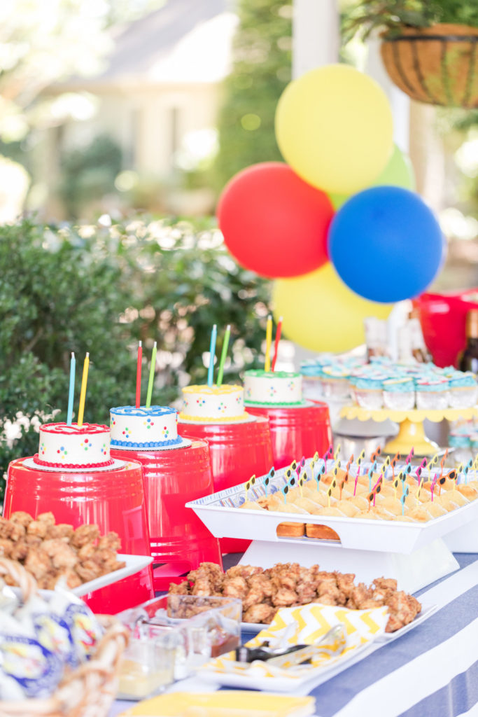 pool party birthday party buffet table with food and balloons