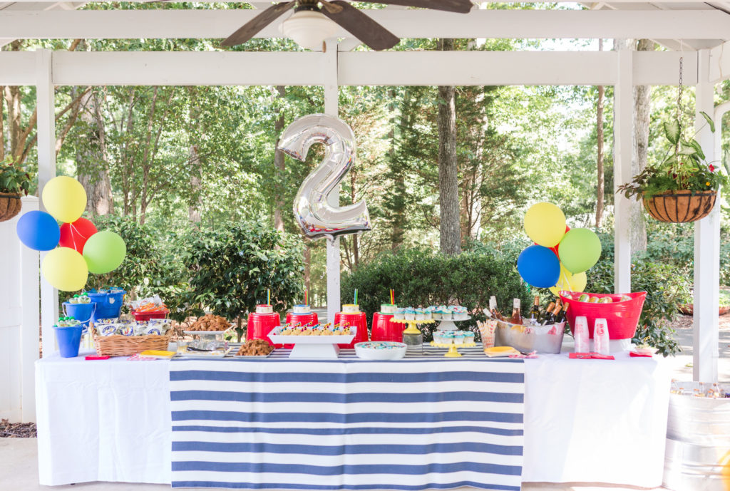 2nd birthday party buffet table with 2 balloons