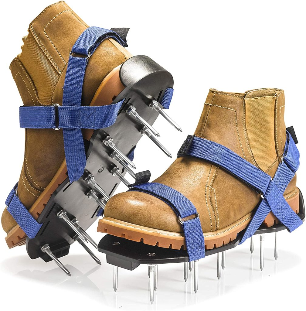 lawn aerator shoes with blue straps and spikes
