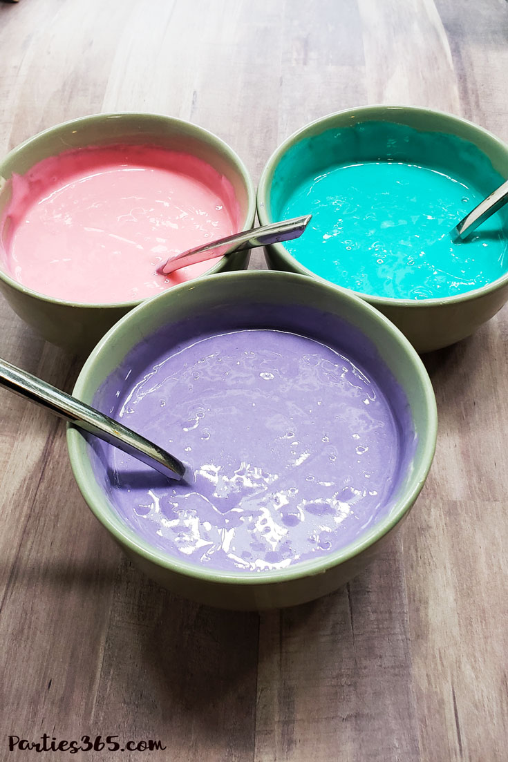 pink, teal and purple cake batter