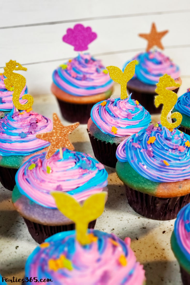 mermaid cupcakes decorated with under the sea cake toppers