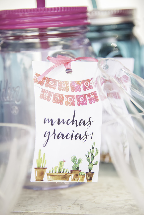 mason jars with thank you notes for party favors at bridal shower fiesta