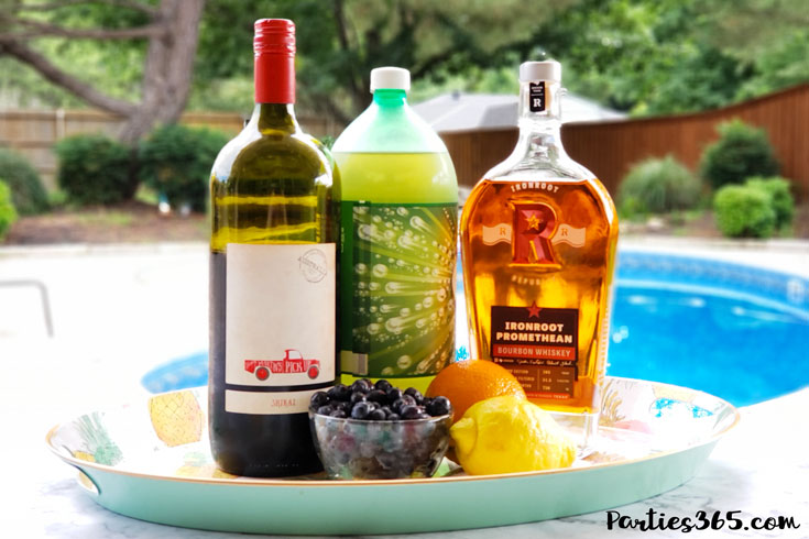 red wine sangria recipe ingredients on a tray by the pool
