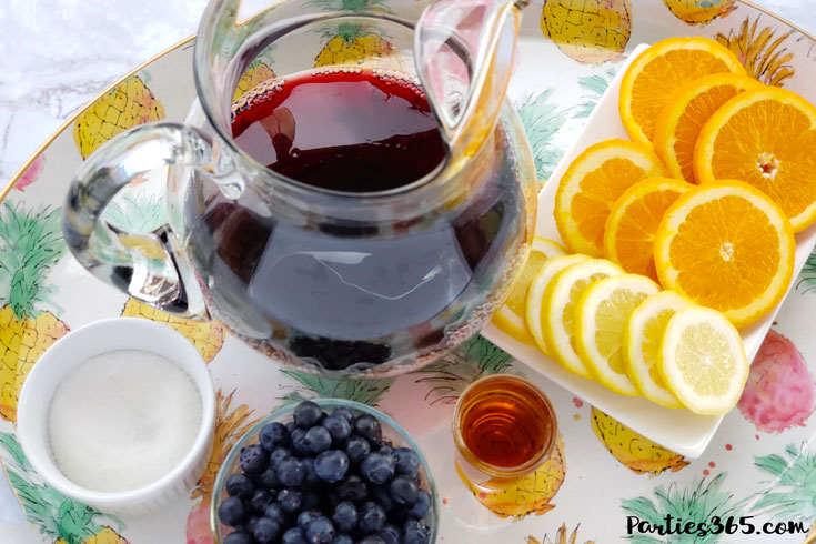 red wine sangria ingredients including blueberries, oranges and lemons