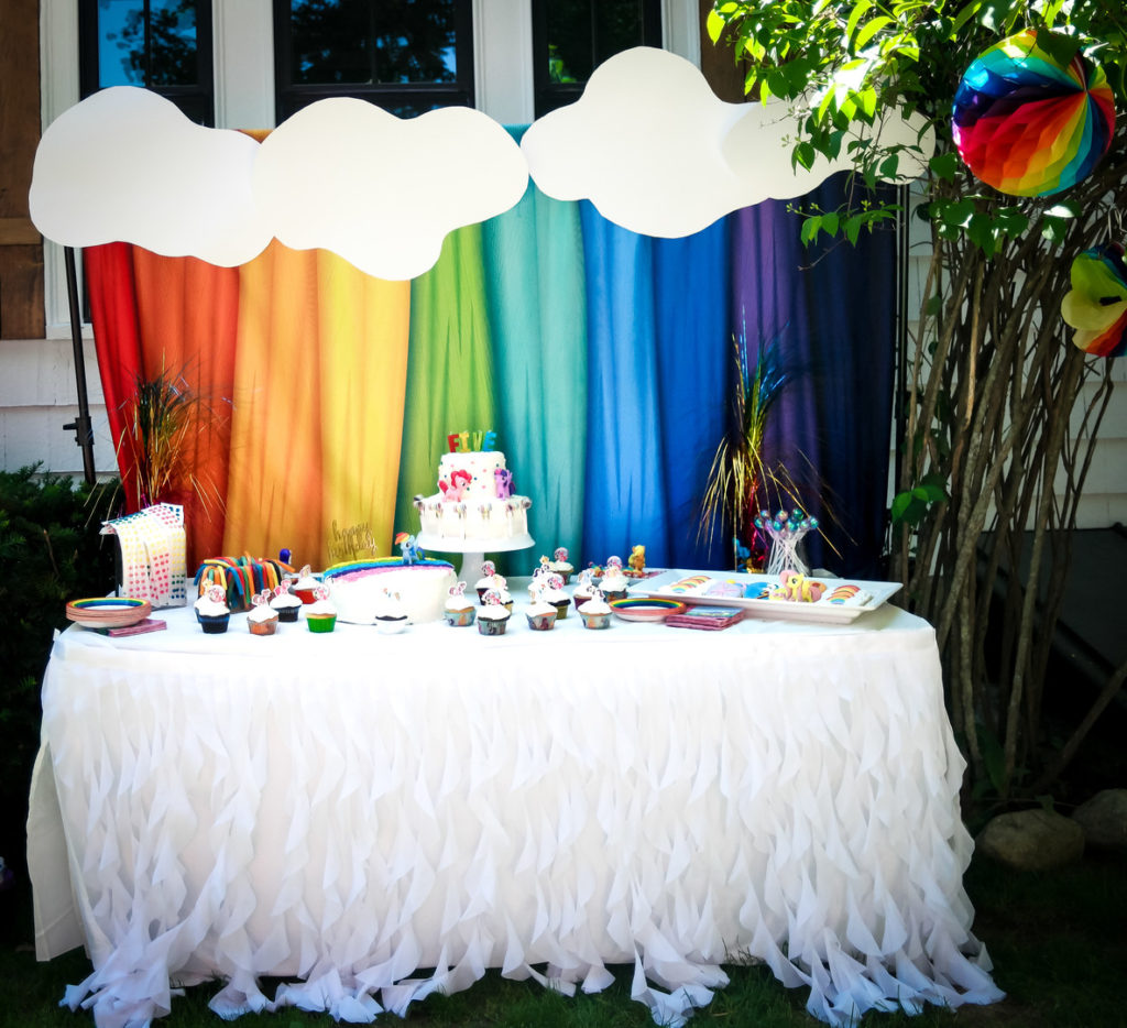 Throw a fabulous My Little Pony Birthday Party for your daughter and her friends with these ideas for a backyard, DIY celebration! Find inspiration for decorations, cake, food, banner, favors and more in this rainbow colored pony party! #mylittlepony #birthdayparty #partyideas #mylittleponyparty