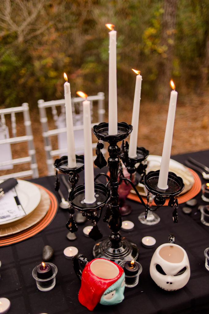 black candelabra on halloween dinner table