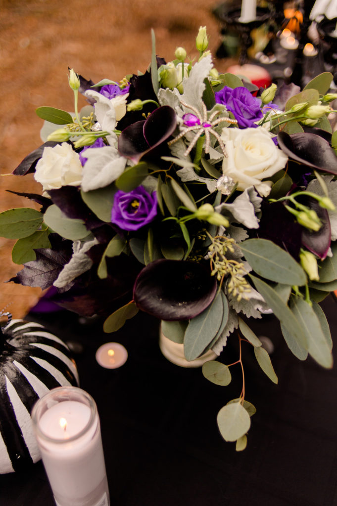 purple white and black floral arrangement for nightmare before christmas halloween table
