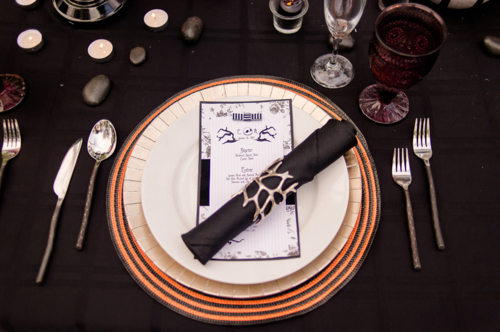 jack and sally place setting with black napkin
