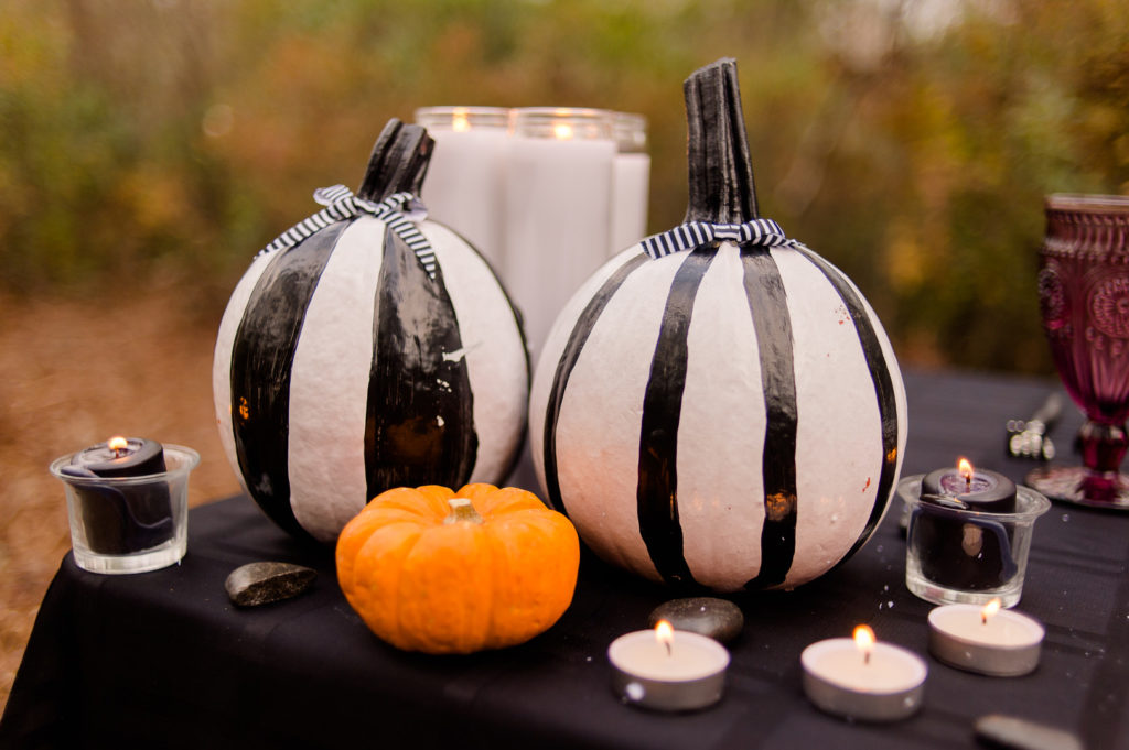 black and white striped pumpkins with bows