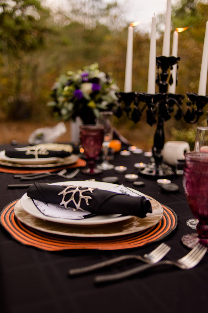 halloween place setting and table decor in black, white and orange
