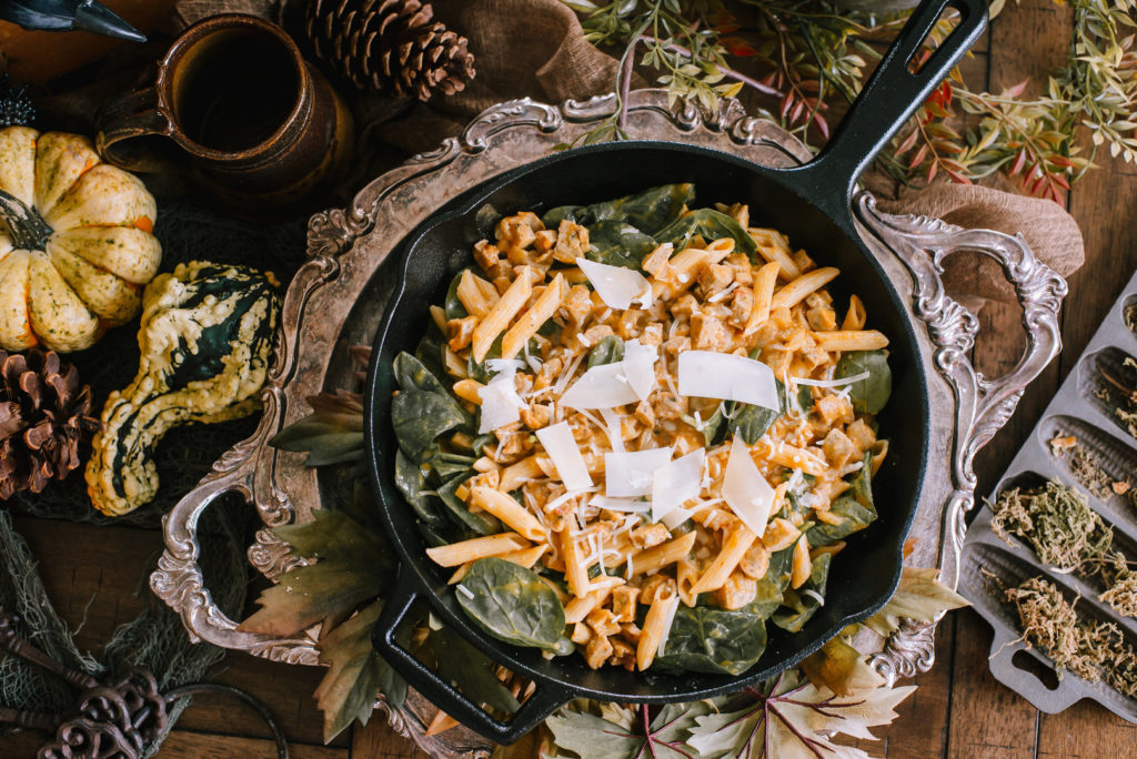 pumpkin pasta in cast iron skillet on fall dinner party table