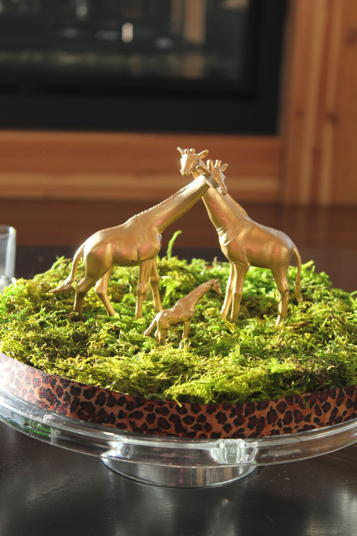 moss centerpiece with gold jungle animals for baby shower