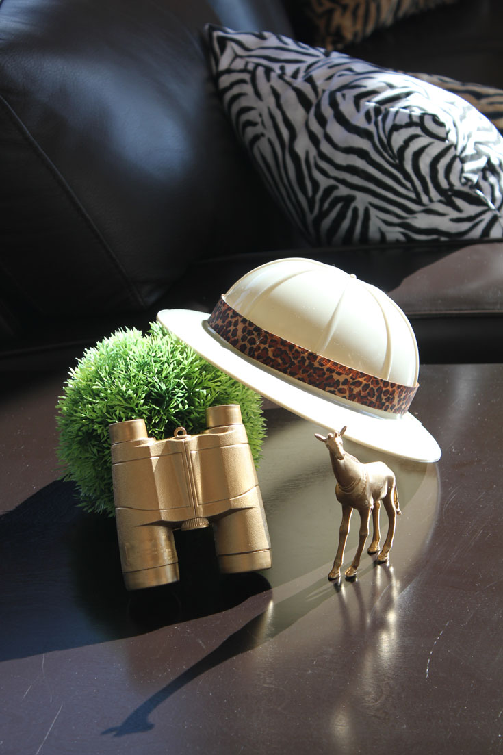 safari hats and gold binoculars for baby shower party decor