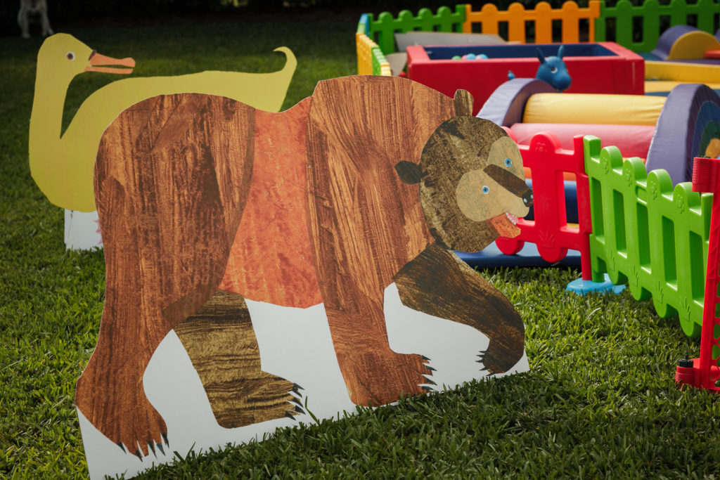 brown bear cardboard cutout at birthday party