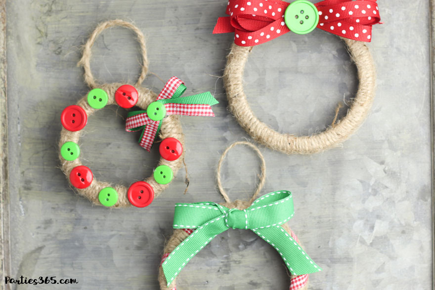 This easy DIY Christmas Mason Jar Lid Wreath craft idea is the perfect ornament for kids to make! It's perfect for teachers, for the tree, for gifts or just as a fun winter project! Instructions and supplies are right here... #christmasornament #christmascraft #christmasDIY #masonjar #masonjarlid