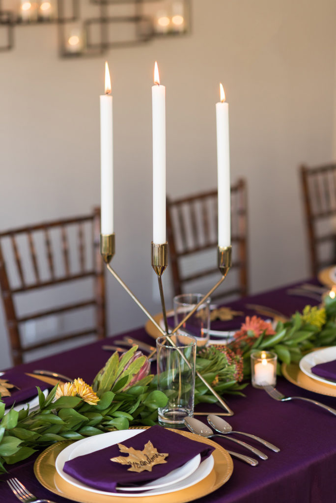 gold geometric candles on thanksgiving table