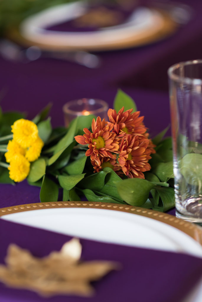orange and yellow flowers on thanksgiving table