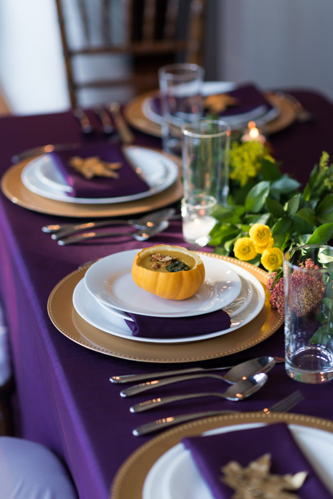 thanksgiving table with squash serving bowl for soup
