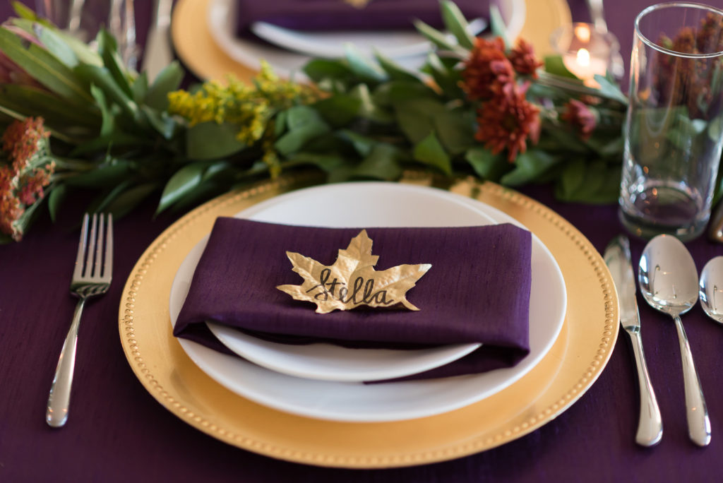 gold leaf thanksgiving place card on purple napkin
