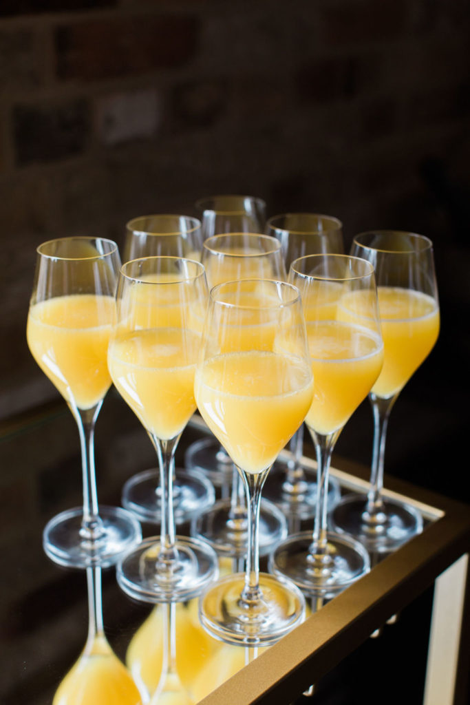 bunch of mimosas in champagne glasses