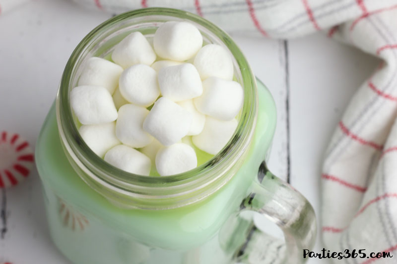 This homemade Mint Hot Chocolate Recipe is creamy, delicious and cooks in the crockpot or slow cooker! The peppermint flavored cocoa is ideal for holiday parties, Christmas morning or Grinch themed parties! Find the easy recipe using condensed milk right here... #holidayrecipe #hotcocoa #hotchocolate #Christmasrecipe #crockpot