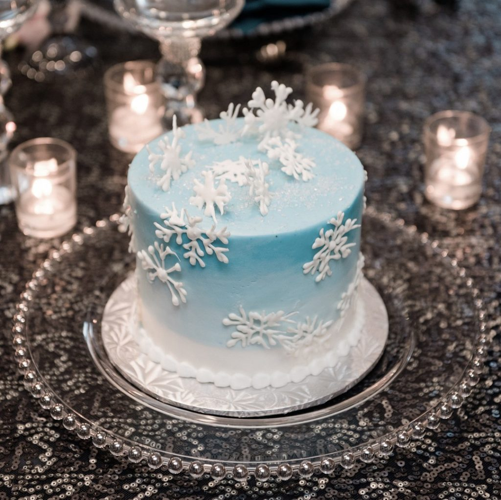 winter cake covered in white snowflakes