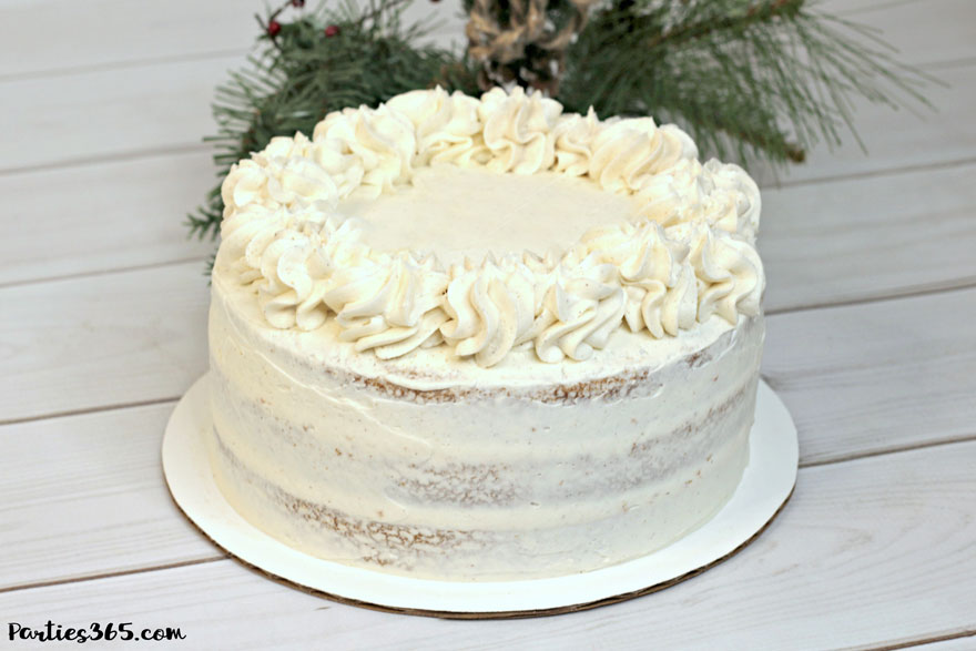 frosted eggnog cake for Christmas on white tray