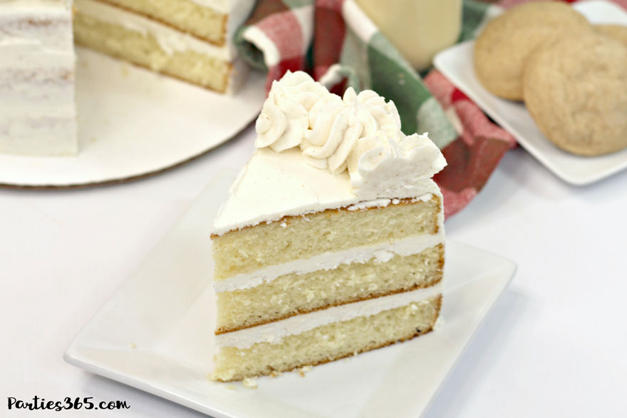 slice of Christmas eggnog cake on white plate