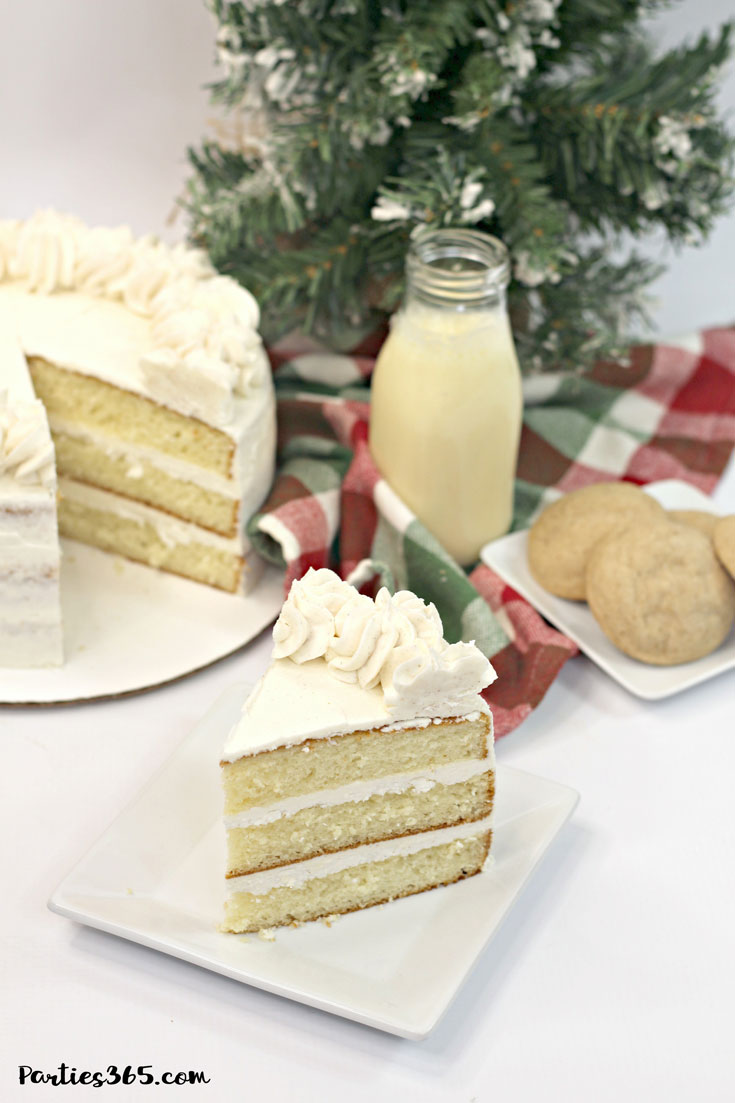 eggnog cake for christmas with glass of eggnog and cookies on a tray