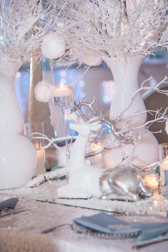 white and silver reindeer centerpiece at winter wonderland baby shower