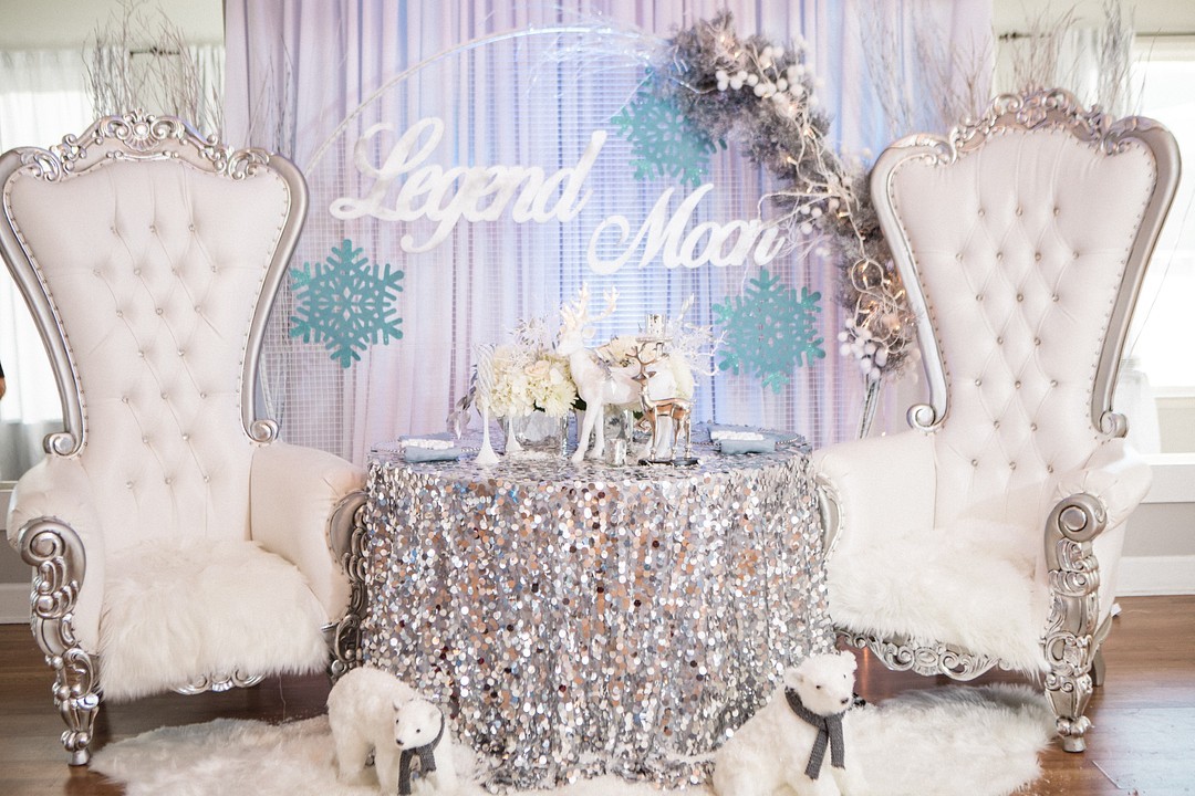 This icy blue and silver Winter Wonderland Baby Shower is a must-see for anyone planning a shower this winter! A perfect theme for boys or girls, this party theme, complete with stunning decorations, centerpieces, cake, snowflakes and more is sure to inspire your decor! #winterwonderland #winterparty #babyshower #partyideas