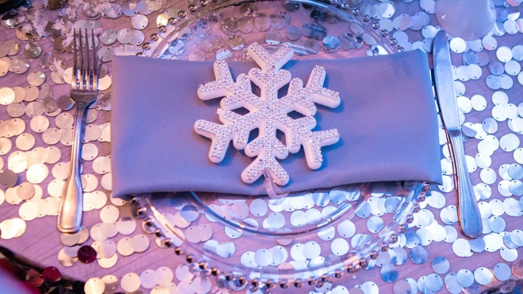 silver snowflake ornament on winter place setting