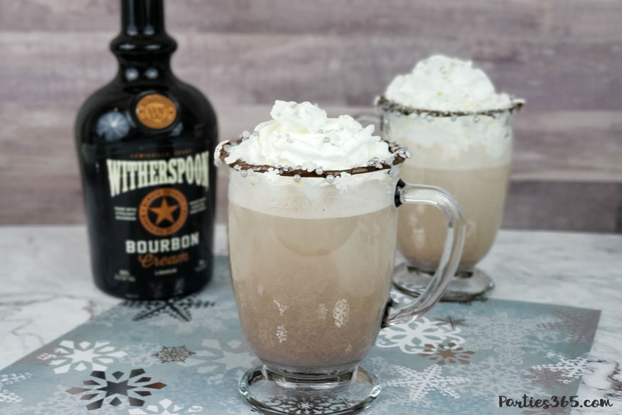 Want to warm up this winter with a delicious cocktail by the fire? Our Boozy Bourbon Hot Chocolate recipe is easy to make and the perfect adult beverage for you and your friends! #cocktail #hotchocolate #cocktailrecipe #winterdrinks