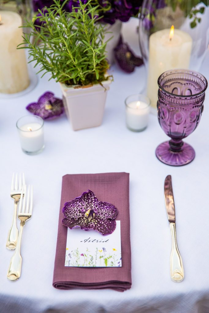 spring place setting with wildflower name card and orchid