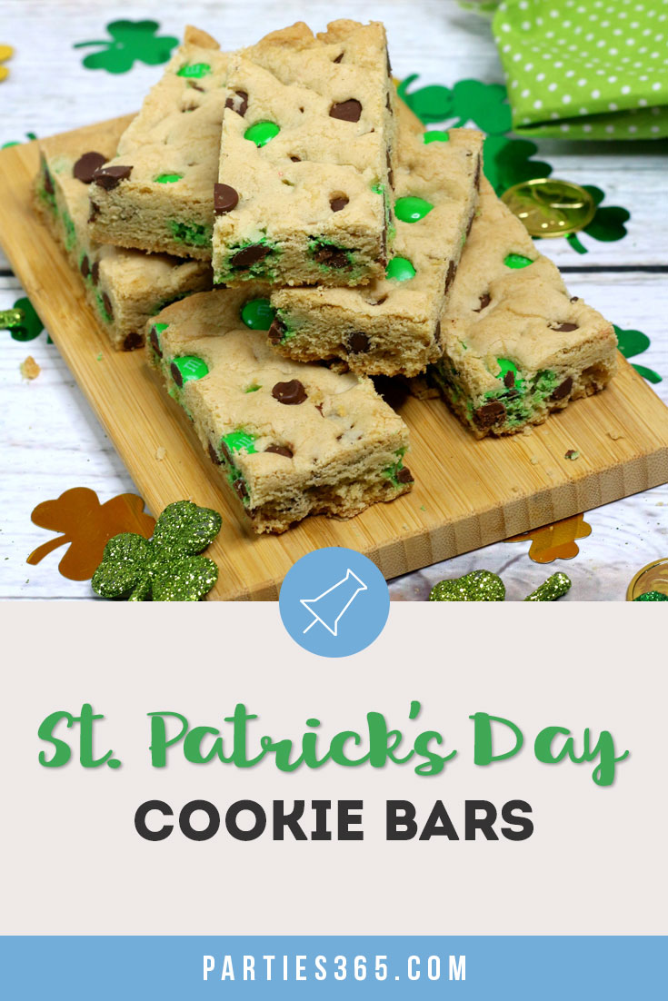 This chewy and delicious St. Patrick's Day Cookie Bar recipe is perfect for a festive dessert! Add chocolate chips and green M&Ms for an easy sheet pan cookie winner!
