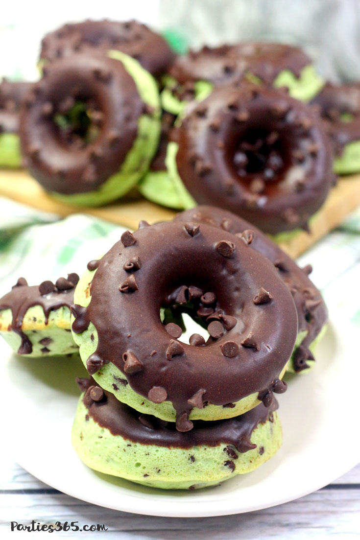 stack of mint chocolate chip donuts on white plate