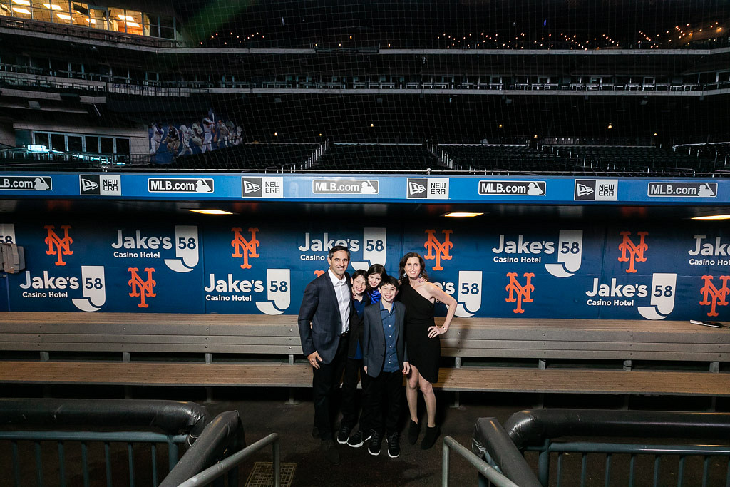 family in dugout at Citi Field